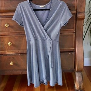 Blue and white striped, flattering faux wrap dress